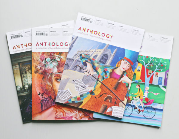 Four issues of Anthology Magazine on a table